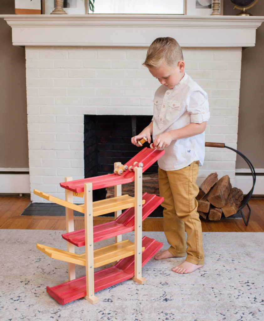 Boy playing with Car Roller Racetrack toy