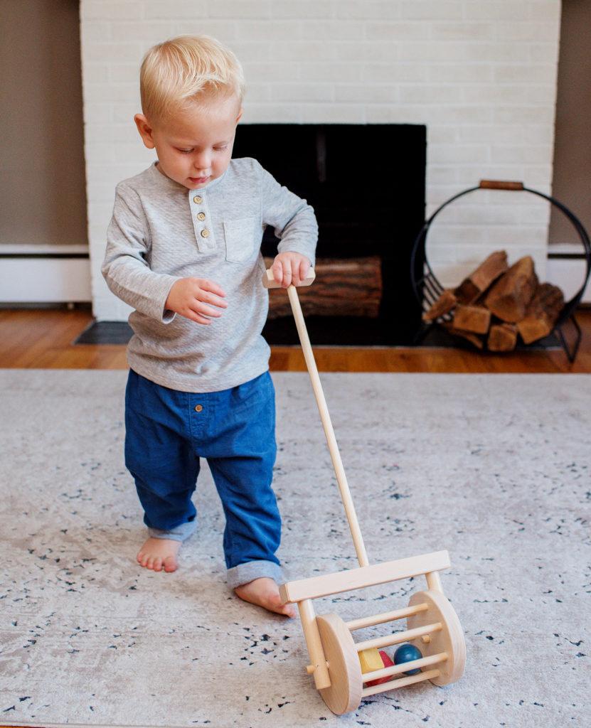 Young boy pushing block roller toy