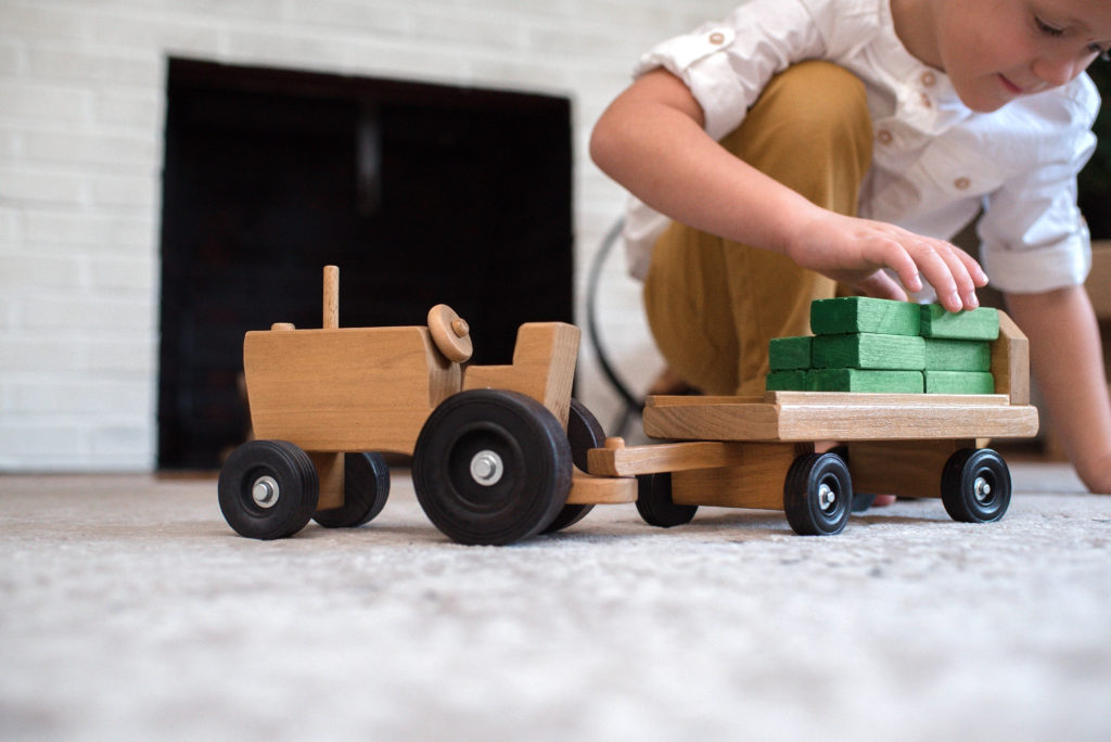boy playing with Tractor Wagon