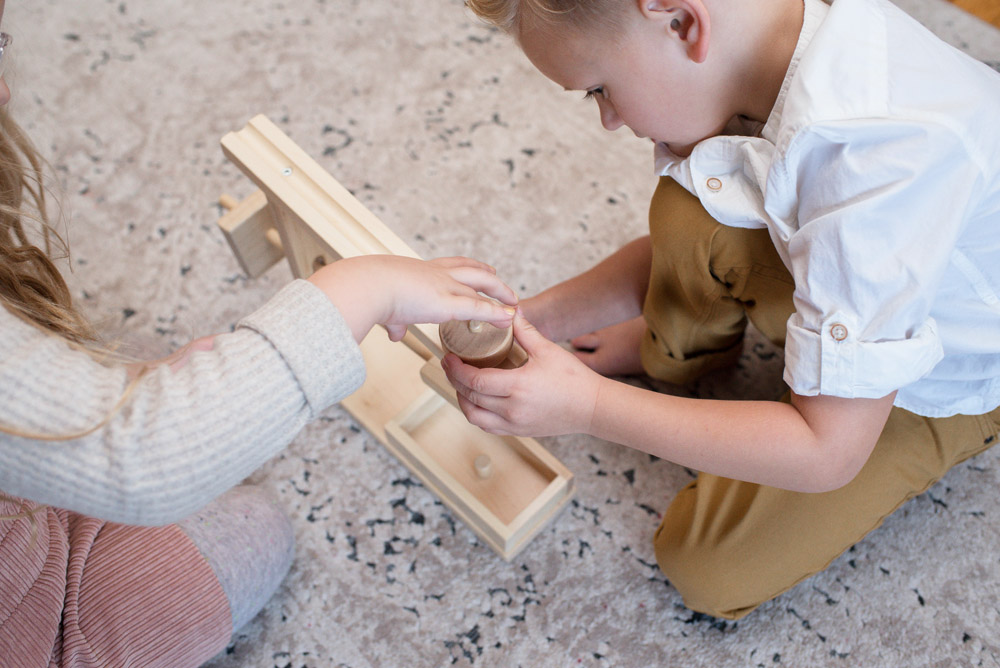 Kids playing with wooden toy